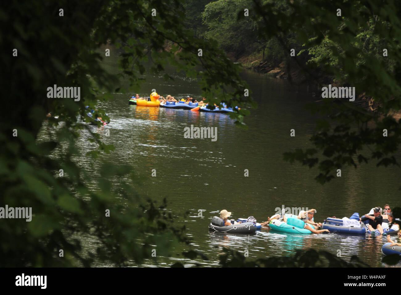 People tubing on Neuse River in North Carolina, USA Stock Photo