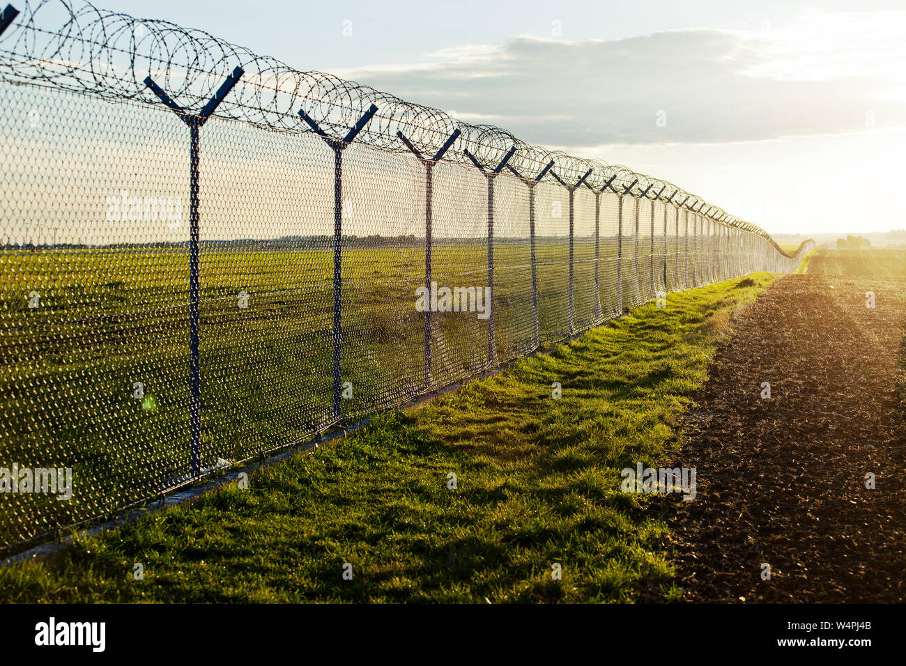 Immigation border barrier Stock Photo