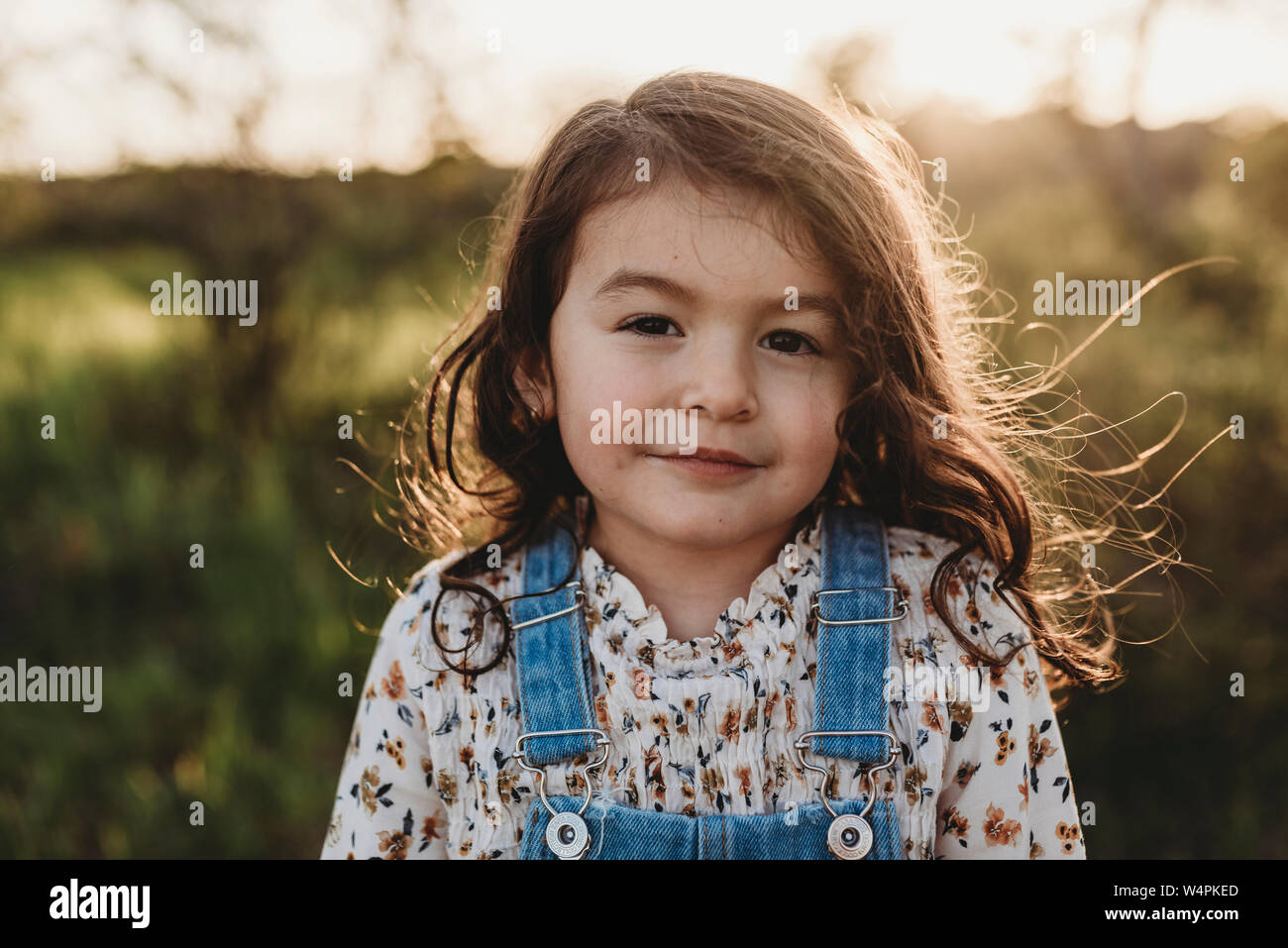 Portrait of young school-aged girl with sunlight in her hair Stock Photo
