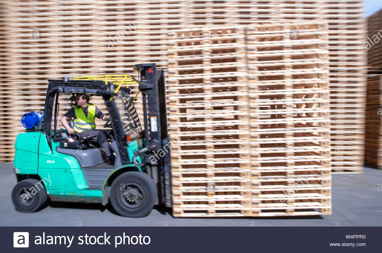 Wismar, Germany  24th July, 2019  An employee uses a forklift truck