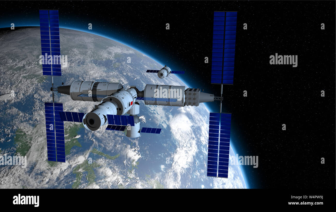 Shenzhou manned space vessel in the direction of coupling to the TIANHE core module in TIANGONG 3 - Chinese space station with the planet Earth behind Stock Photo