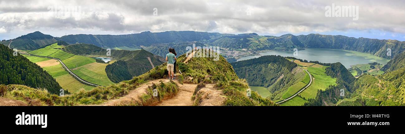 Pico Da Cruz.Young Couple Enjoy The Panoramic View Of Crater Sete Cidades