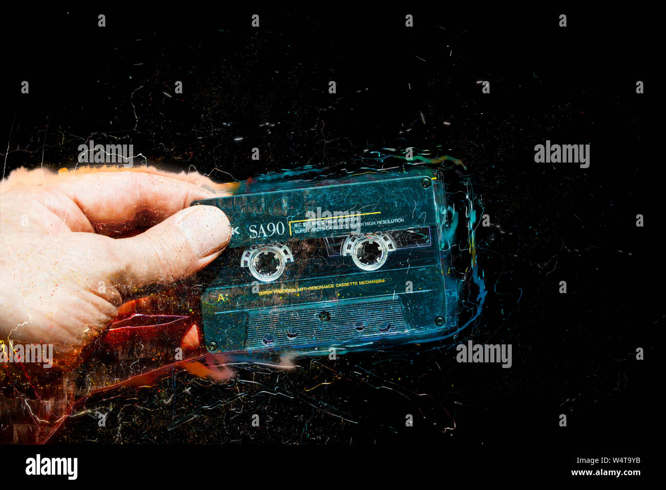 Concept image of an audio cassette tape bursting with musical energy Stock Photo
