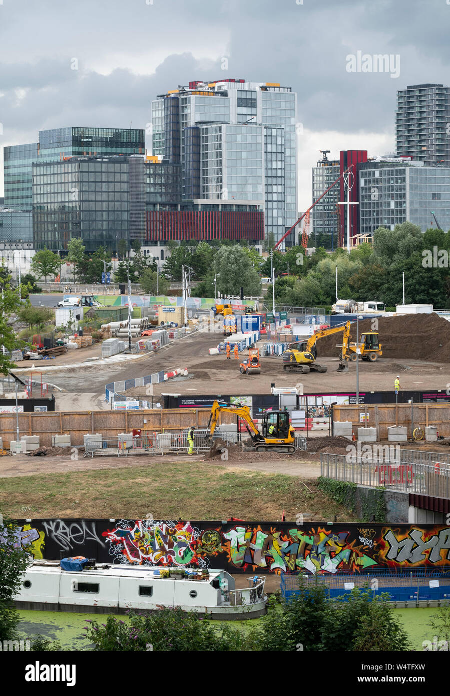 East Wick and Sweetwater development building site in the Queen Elizabeth Olympic Park, East London, UK, with the International Quarter behind. Stock Photo