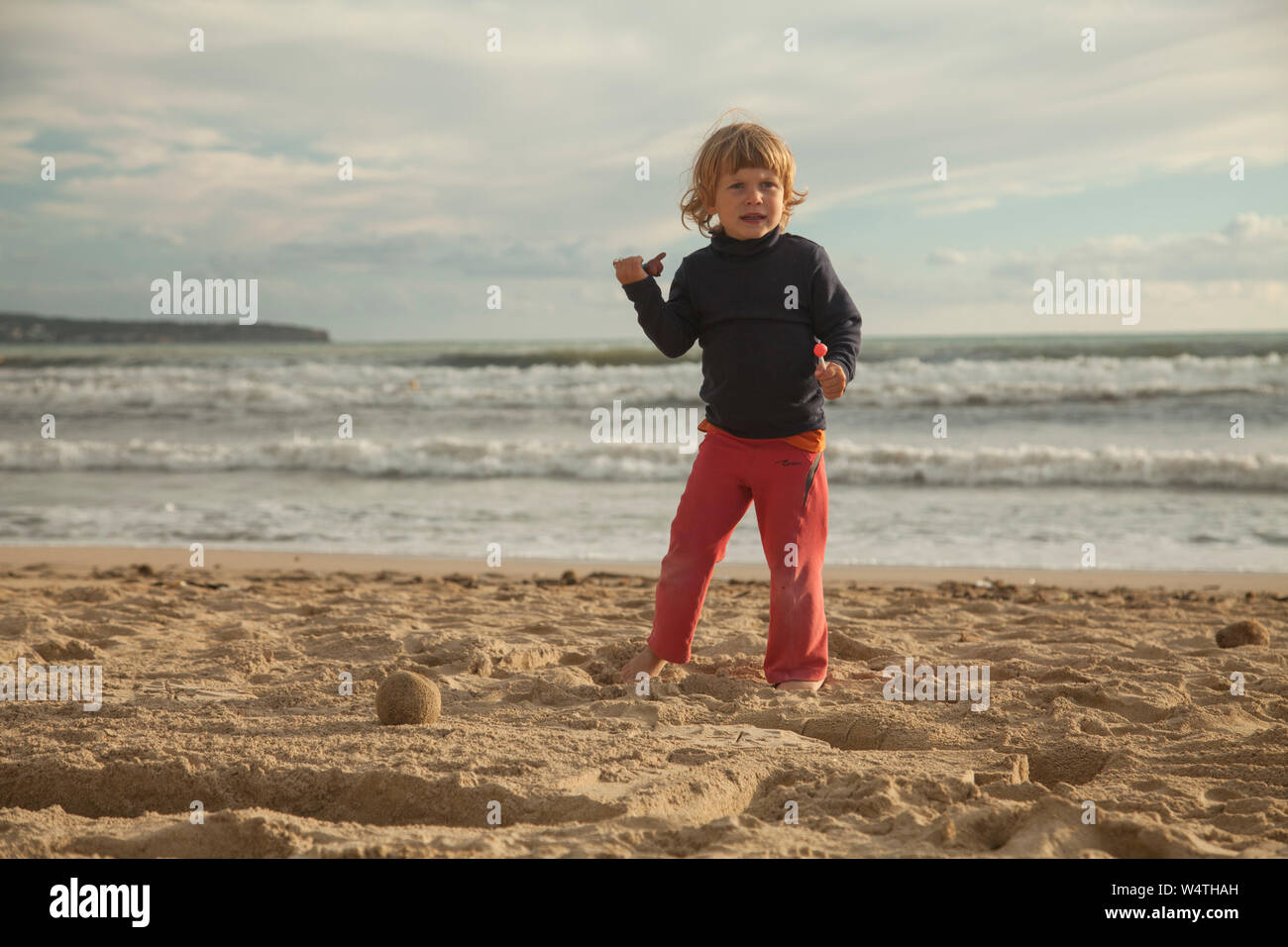 Little Blond Girl Playing On The White Beaches Of Palma De Mallorca Spain Stock Photo Alamy