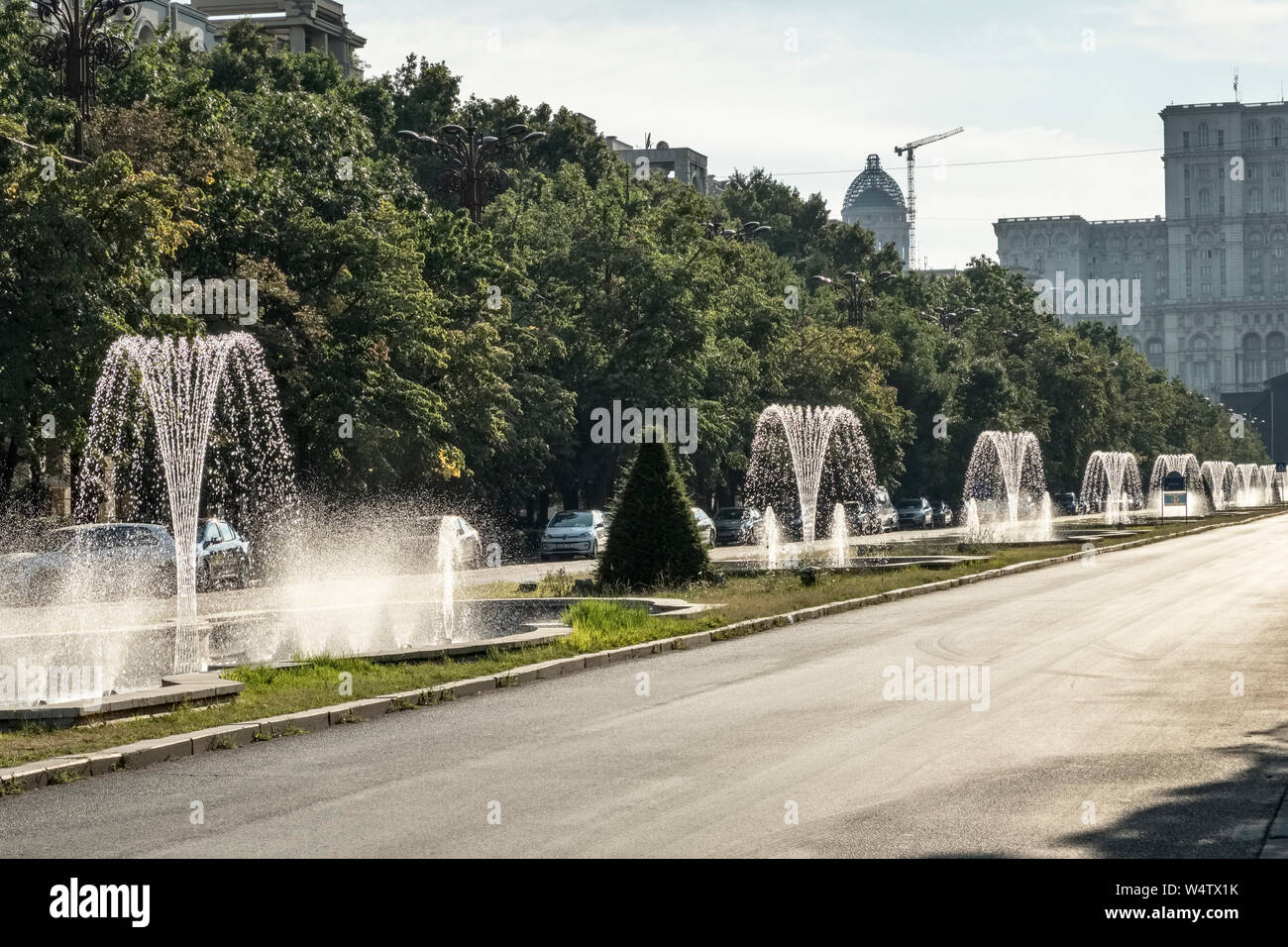 Fountains on Unirii Boulevard, Bucharest, Romania (Bulevardul Unirii). It runs from Piața Unirii (Unification Square) to the Palace of the Parliament Stock Photo