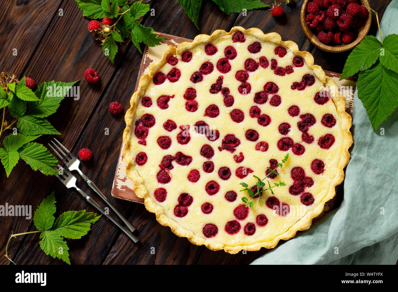 Berry pie summer. Sweet pie, tart with fresh berry raspberries. Delicious cake with raspberries. Top view flat lay. Stock Photo