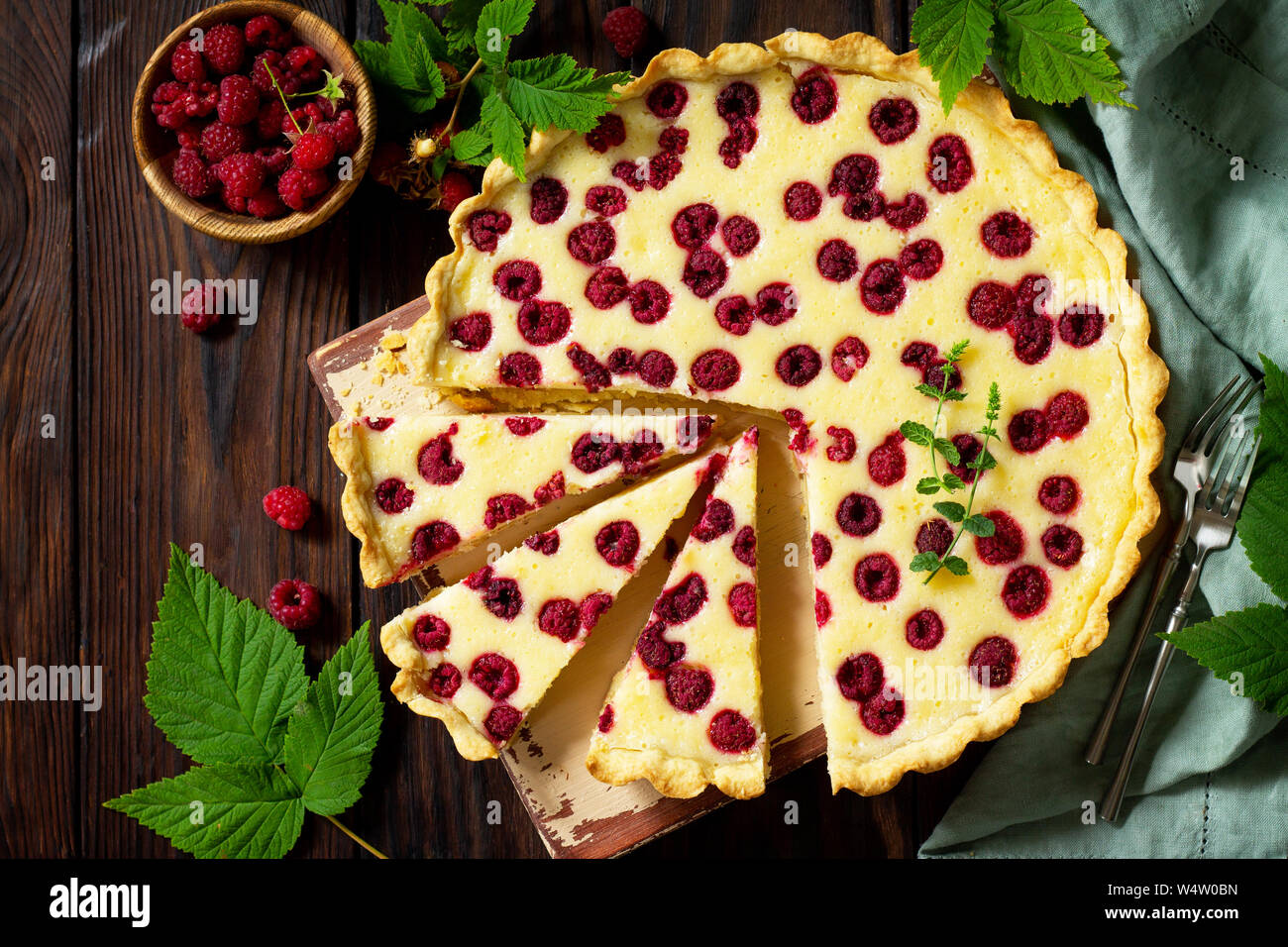 Berry pie summer. Sweet pie, tart with fresh berry raspberries. Delicious cake with raspberries. Top view flat lay with copy space for your text. Stock Photo