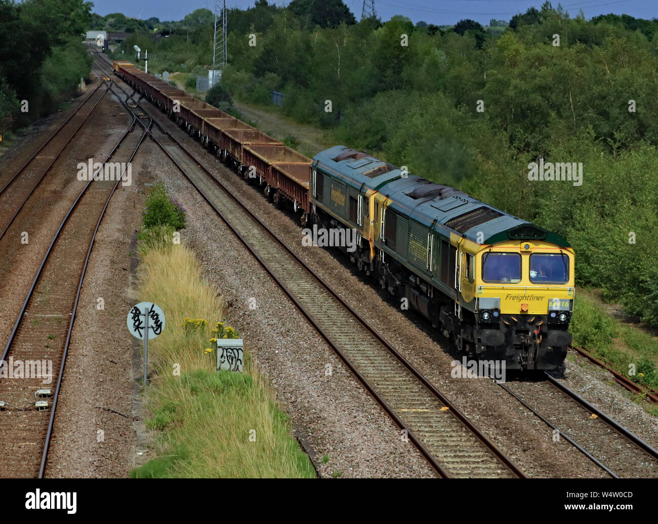 Freightliner locomotives no's 66416 and 66613 pass North Stafford Junction in near Willington in Derbyshire hauling a freight train. Stock Photo