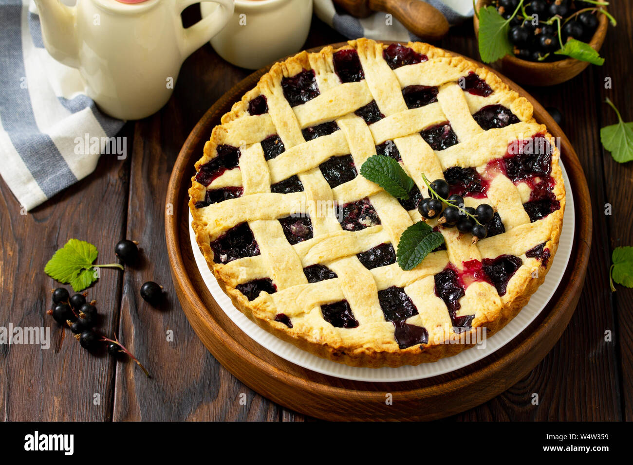 Berry pie summer. Sweet pie, tart with fresh berry currant. Delicious cake with currant. Free space for your text. Stock Photo