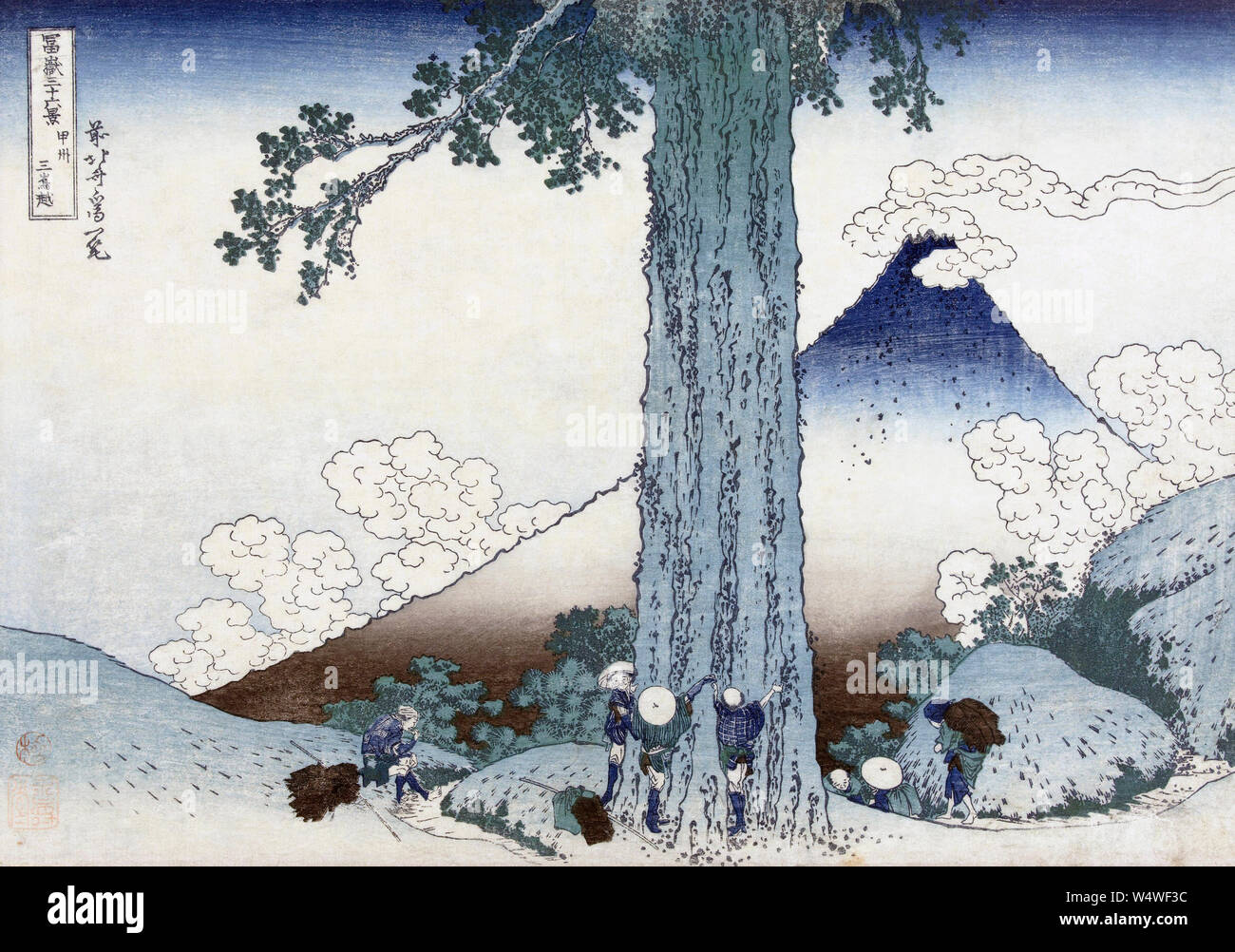 Mishima mountain pass in Kai province,  Japan, showing Mt Fuji.  After a woodblock print dating from circa 1830 by Japanese artist Katsushika Hokusai, 1760 - 1849.  The woodblock is part of a series known as Thirty-six Views of Mount Fuji. Stock Photo