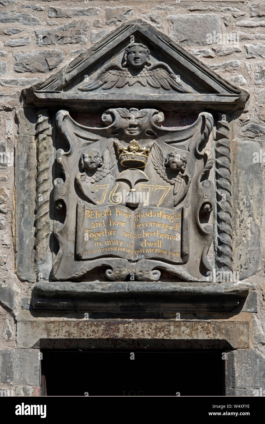 17th Century carving at the doorway to Bible Land, a restored 17th century tenement building, in the Canongate on the Royal Mile, Edinburgh, Scotland. Stock Photo