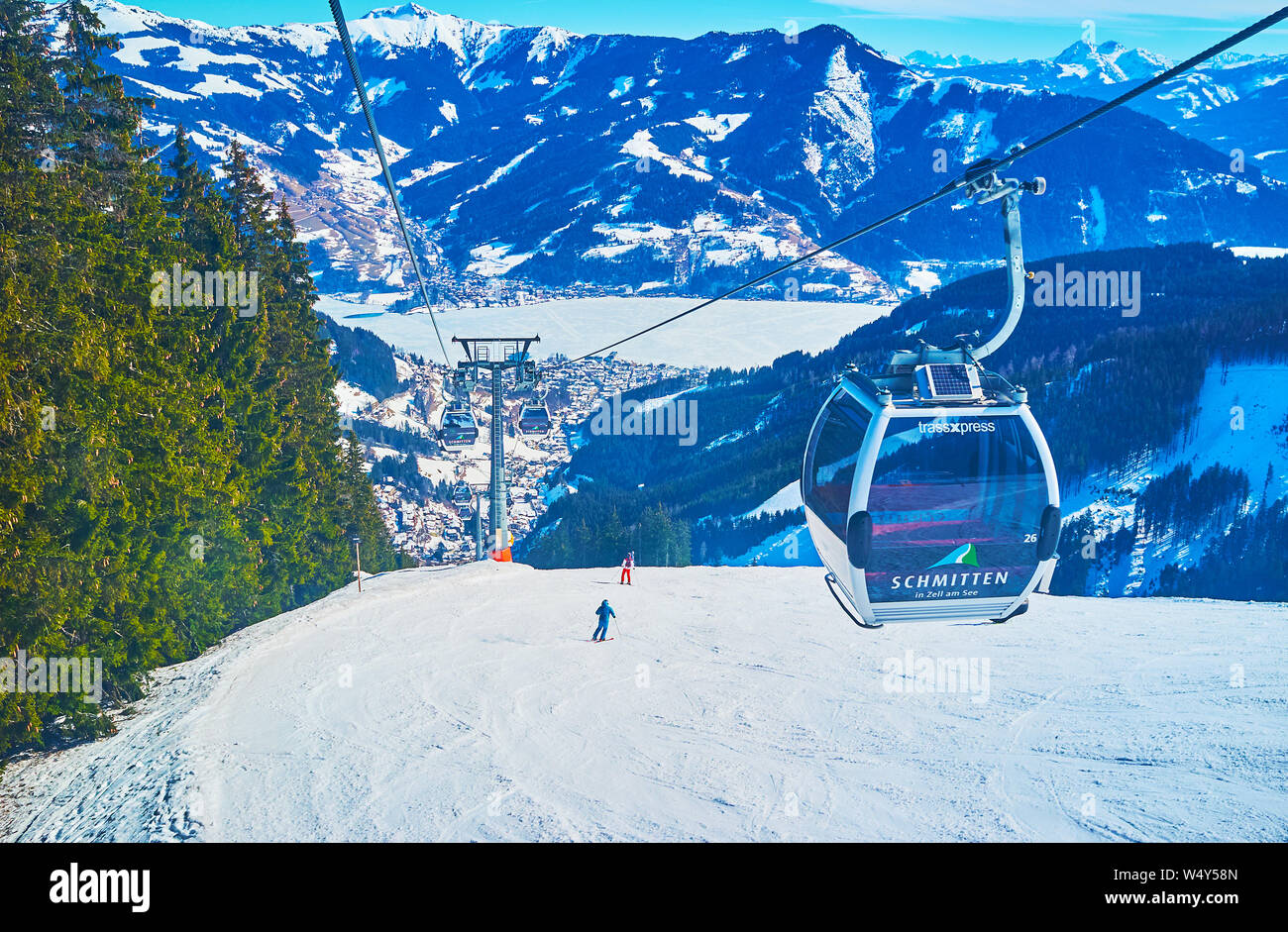 ZELL AM SEE, AUSTRIA - FEBRUARY 28, 2019: The scenic mountain landscapes from the Trassxpress cableway, riding along the snowy slope of Schmitten moun Stock Photo