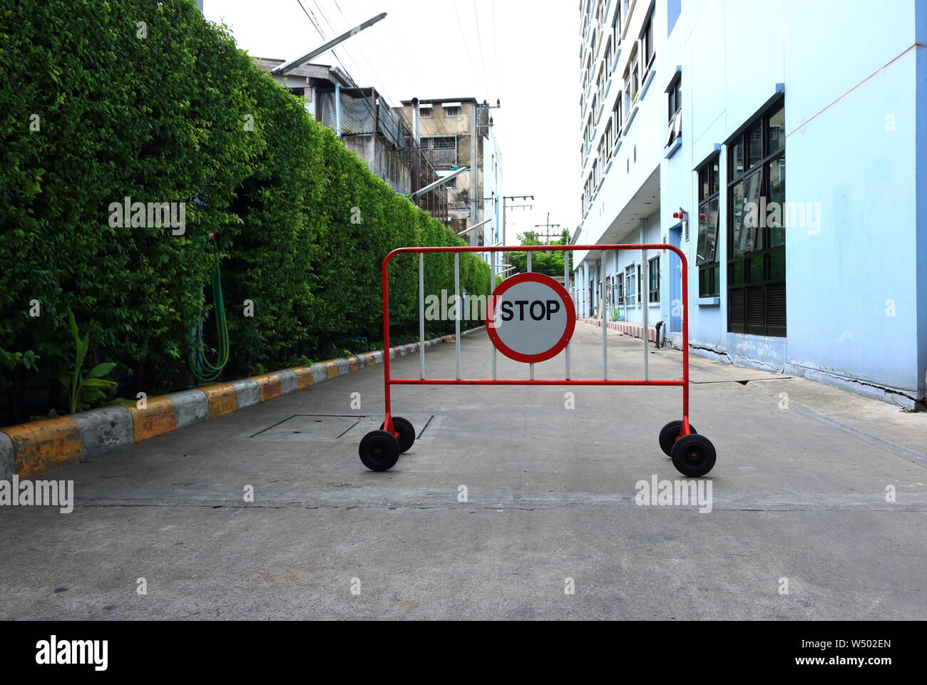 Closeup of stop sign standing on street, safety concept Stock Photo