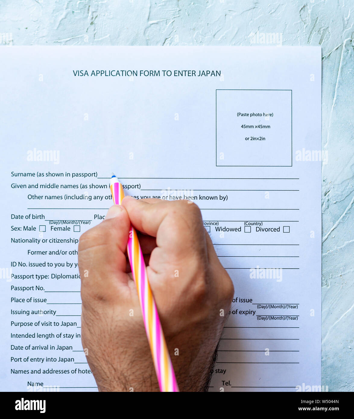 The Person Filling The Visa Application Form To Enter Japan Stock Photo Alamy