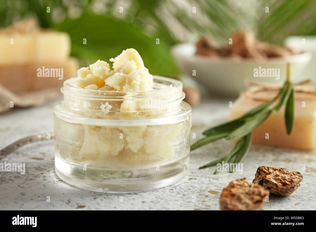 Jar with shea butter on table Stock Photo