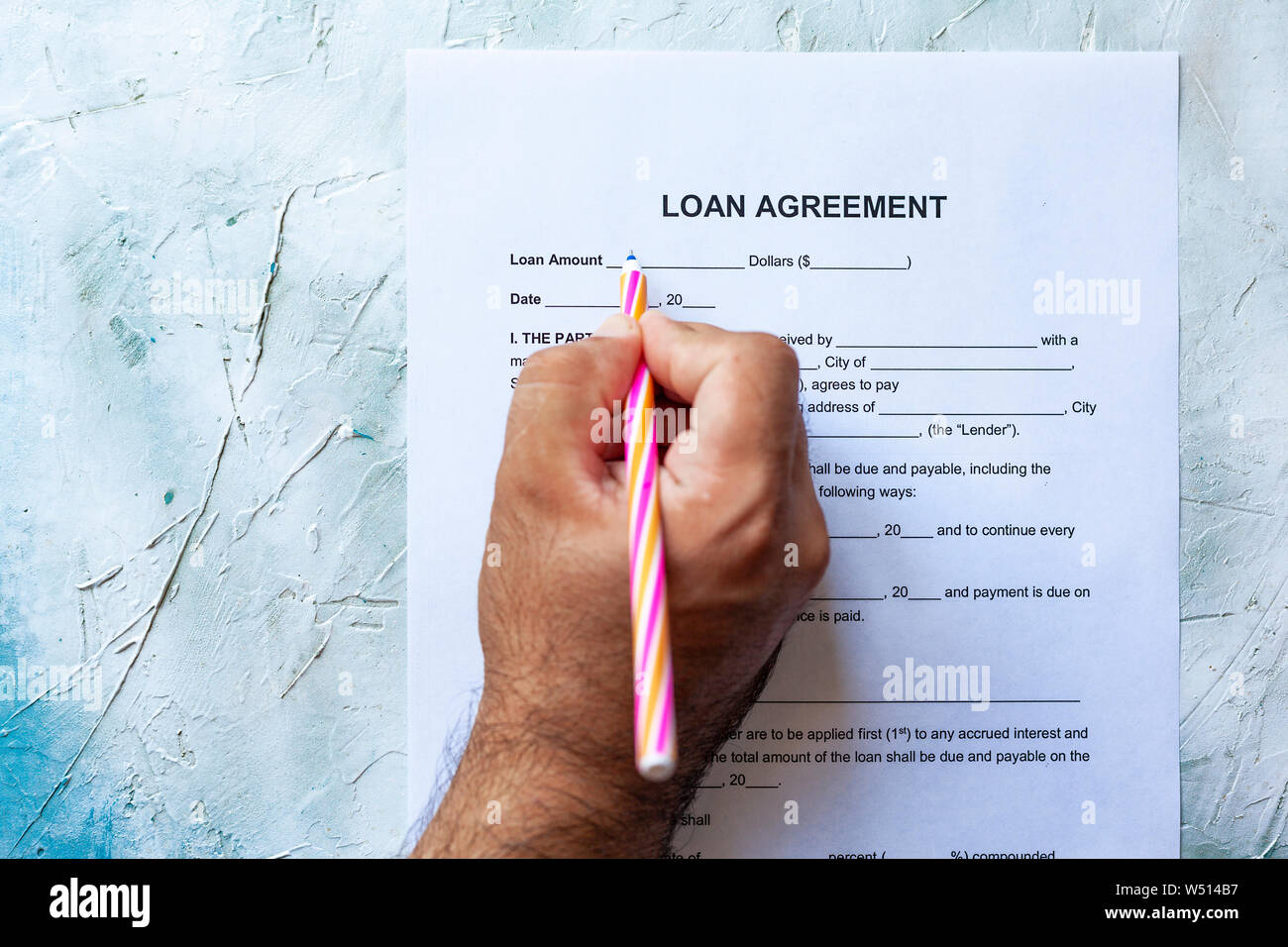 Person Filling Blank Loan Agreement Form Top View Stock Photo Alamy
