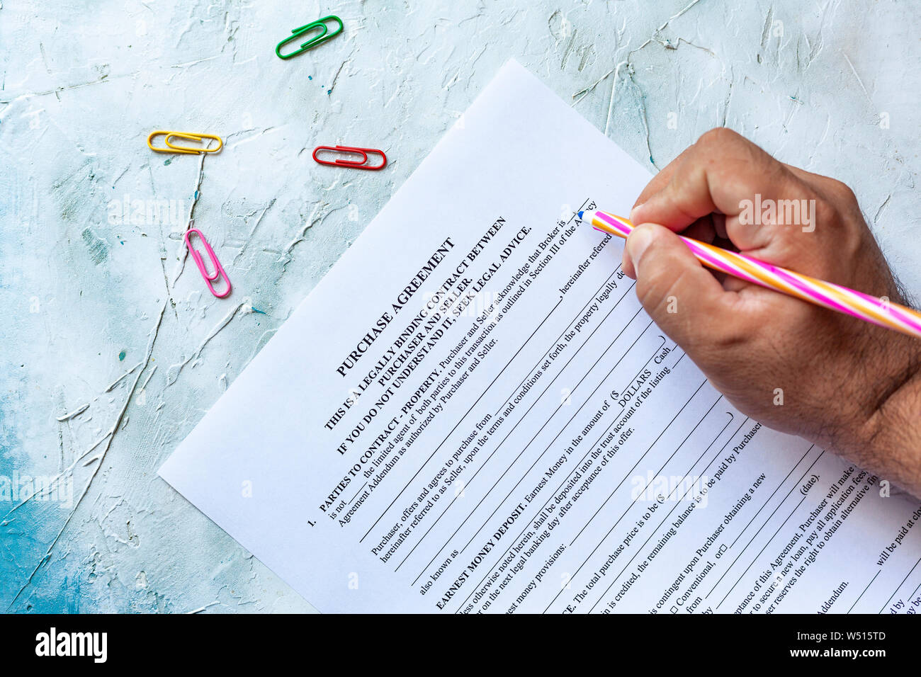 Person Filling Blank Purchase Agreement Form View From