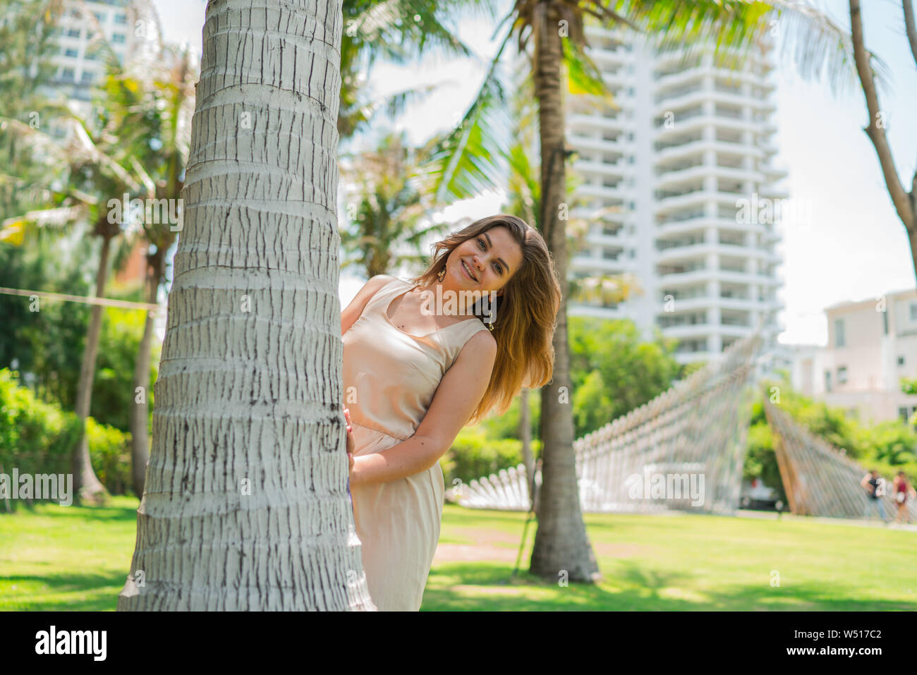 Girl Behind Coconut Tree High Resolution Stock Photography and Images -  Alamy