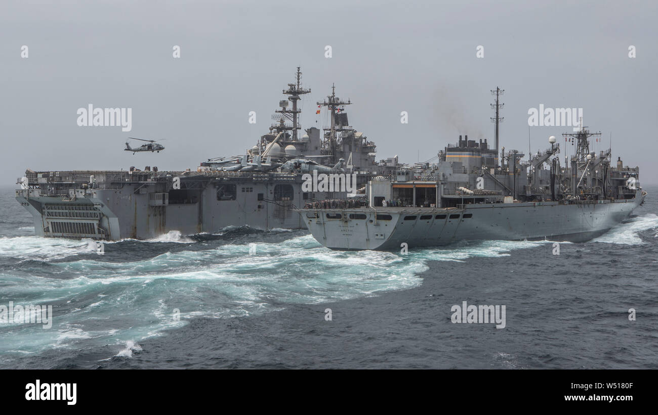 190714-M-QS181-1004 ARABIAN SEA (July 14, 2019) The amphibious assault ship USS Boxer (LHD 4) (left), receives supplies from the USNS Arctic (T-AOE-8) during a replenishment-at-sea. The Boxer Amphibious Ready Group and the 11th MEU are deployed to the U.S. 5th Fleet area of operations in support of naval operations to ensure maritime stability and security in the Central Region, connecting the Mediterranean and the Pacific through the Western Indian Ocean and three strategic choke points. (U.S. Marine Corps photo by Cpl. Jason Monty) Stock Photo