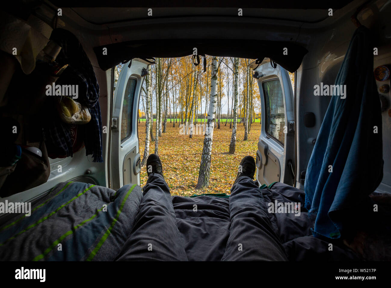 Van life backdoor view during a road trip in Poland. Stock Photo