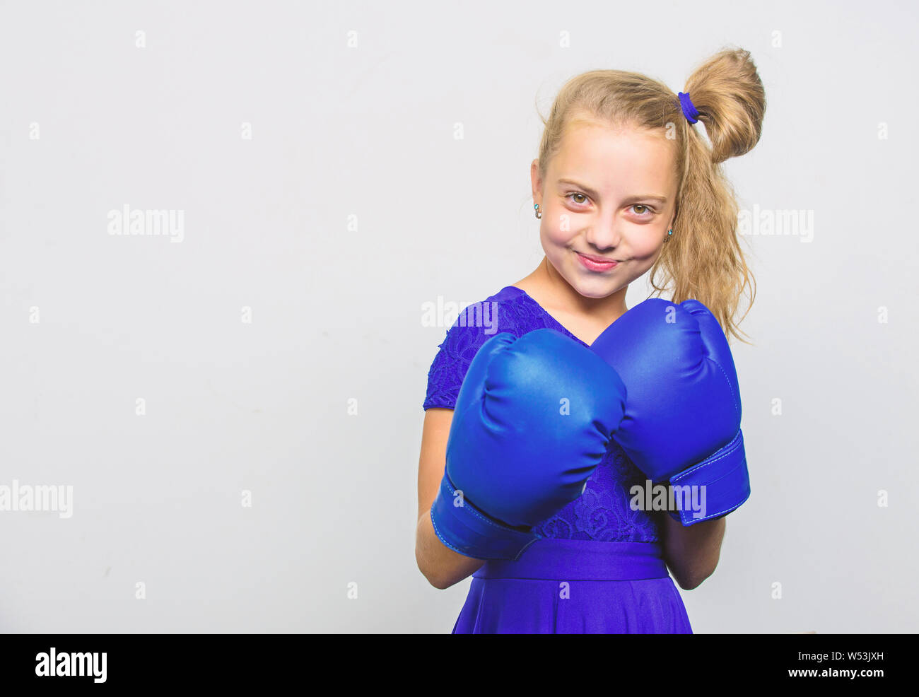 little girl in boxing gloves punching  knockout and energy  Sport