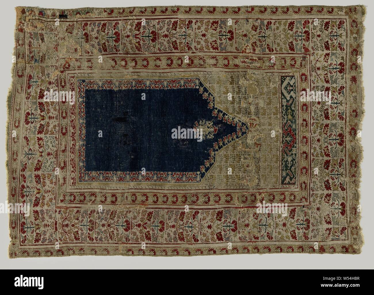 Oriental Carpet Prayer Rug Made Of Knotted Wool Decorated With A Corn Blue Mihrab Pointed And Toothed Top In Which A Stylized Lamp Hangs Beige Sprays With Plant Leaves Around The Midfield Three