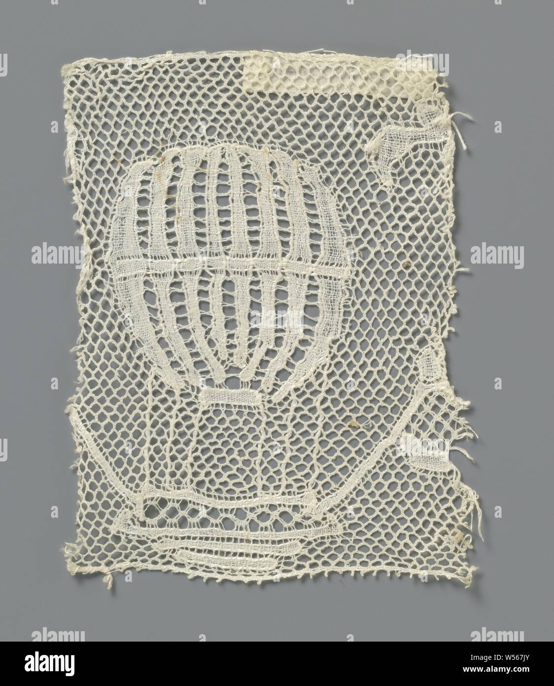 Strip of bobbin lace with hot air balloon, Strip of natural-colored bobbin lace: Antwerp side. On the short cut strip you can see a hot air balloon, which is originally part of a larger pattern that has been cut off. The balloon is made in a lattice soil, a Valenciennes soil. The motifs are made in linen with openwork edges and thicker, shiny contour threads. Standing pairs and single lace-hole strokes between the closed stripes in the balloon create a decorative effect in the open-worked stripes. In the upper part of the basket a decorative ground is used as an ornamental ground (with Stock Photo