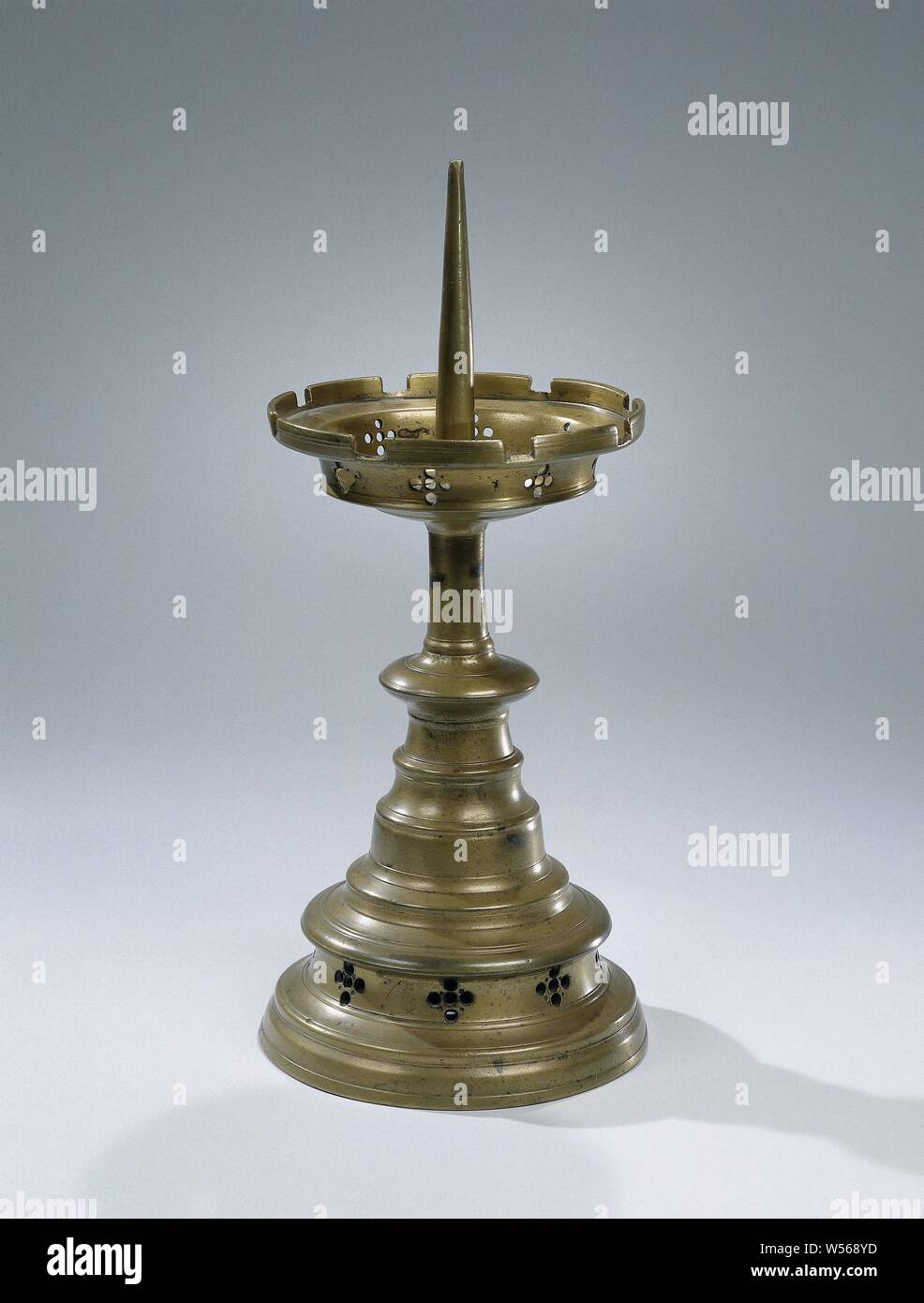 Candlestick with profiled foot and stem with a candle pin