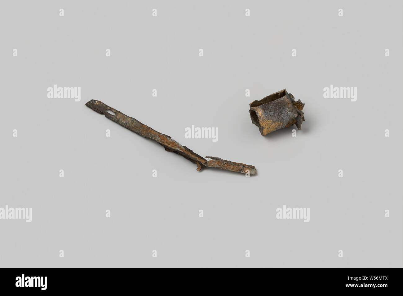 Metal fittings from the wreck of the East Indies ship 't Vliegend Hart, Two fragments, a copper strip and a ring. Metal strip, Dutch East India Company, 't Vliegend Hart (ship), Middelburg, 1729 - 2-Mar-1735, copper (metal), h 1 cm d 0.9 cm h 0.3 cm w 3.6 cm × d 0.2 cm Stock Photo