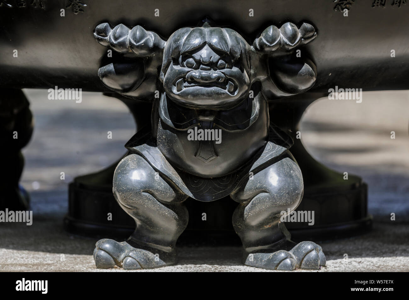 Carved figure on a giant urn at Gotokuji Temple in Setagaya city, Tokyo, Japan. Stock Photo