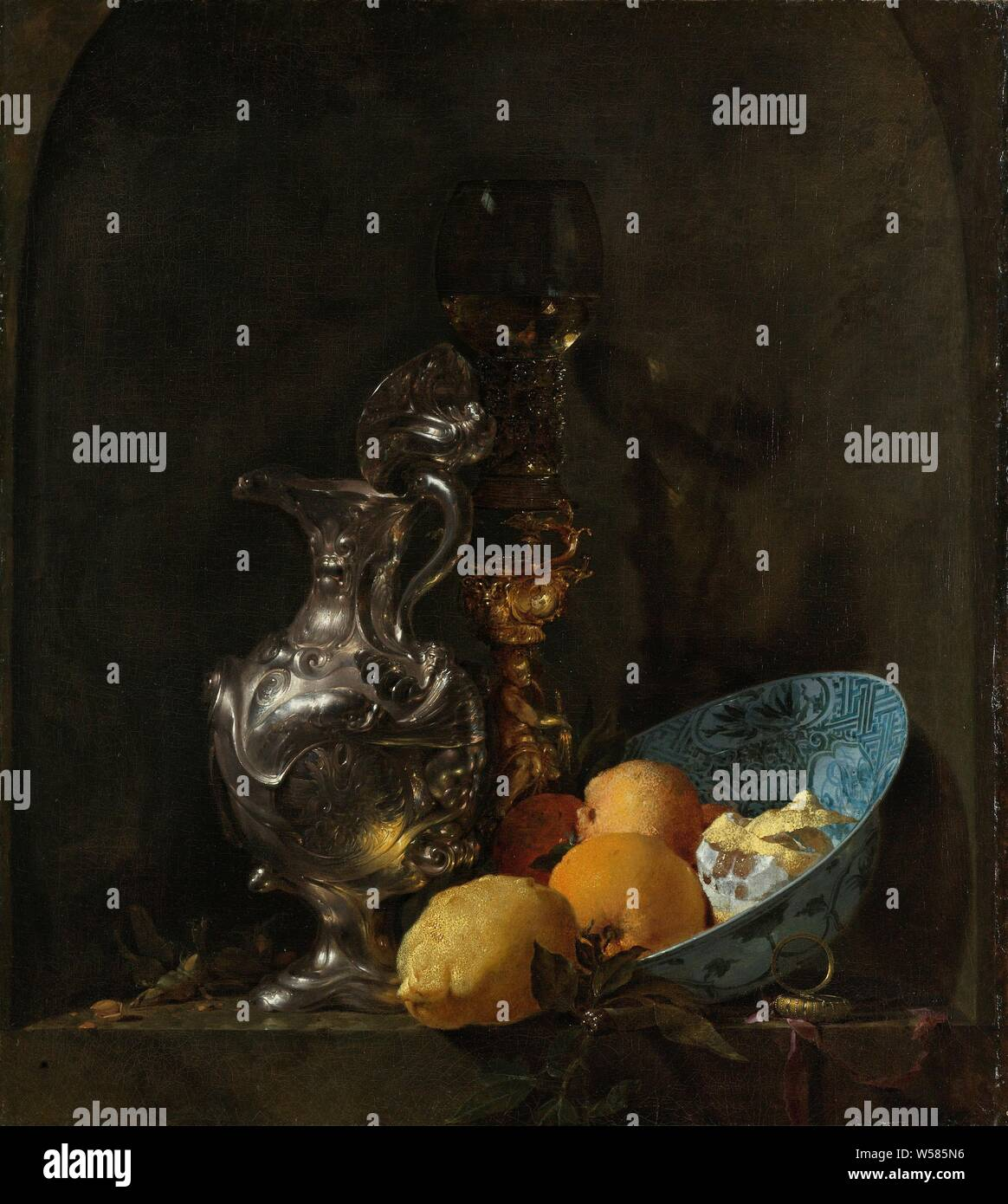 Still Life with a Silver Jug and a Porcelain Bowl Still Life with a Silver Ewer Still Life with a Silver Jug, Still life with an ornamental silver jug with lid, a cup screw with a rummer with white wine, a Wan Li bowl with lemons and oranges and a watch, still life of various objects, container of precious metal, glass of wine, fruits: lemon, watch, Willem Kalf, 1655 - 1660, canvas, oil paint (paint), h 73.8 cm × w 65.2 cm Stock Photo