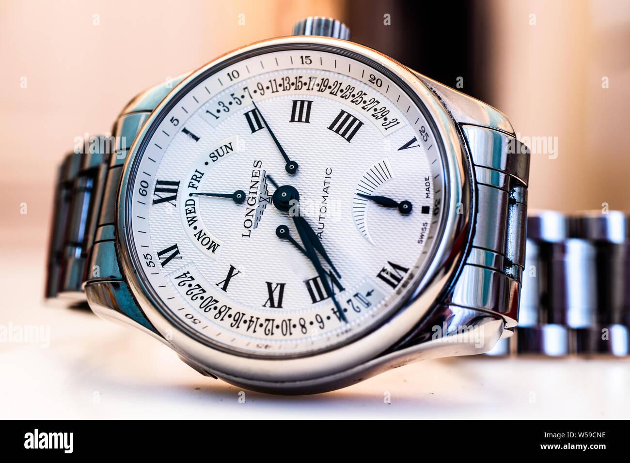Lodz, Poland, Apr 2019 Longines hand watch, macro, luxury watch company, Longines winged hourglass logo registered 1889 is oldest unchanged trademark Stock Photo