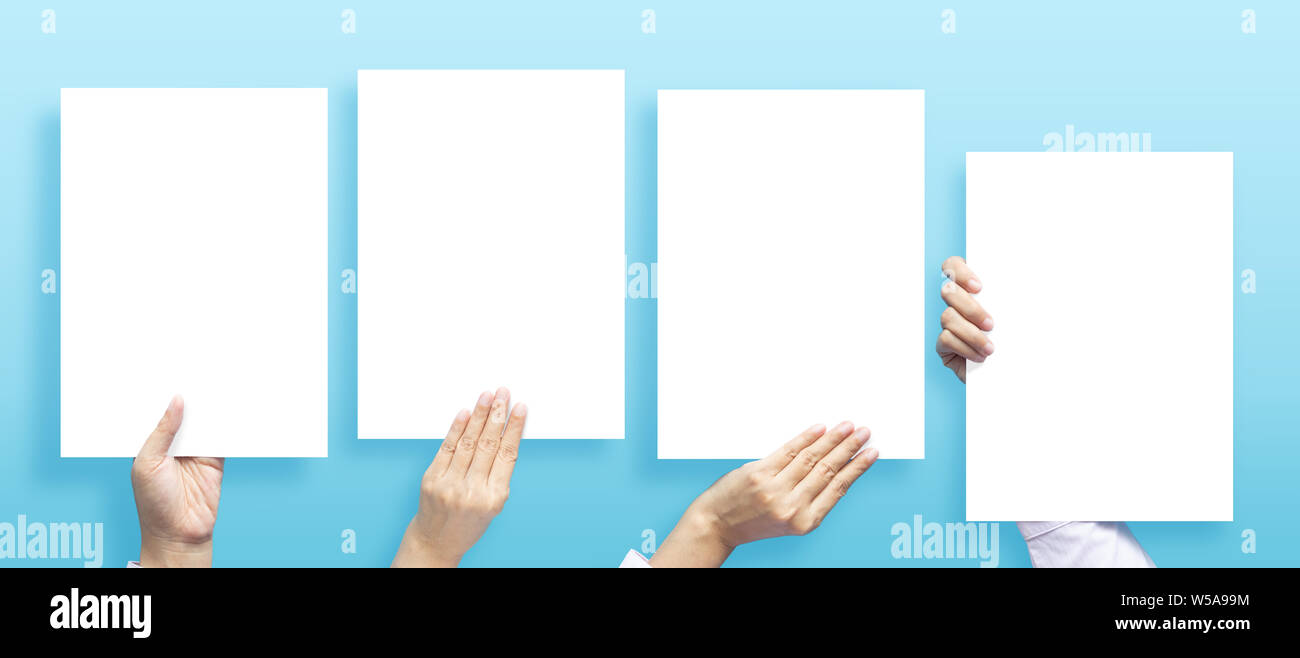 set of hands holding empty white blank letter paper size A4 for flyer or invitation mock up in different composition isolated on a blue background. Stock Photo