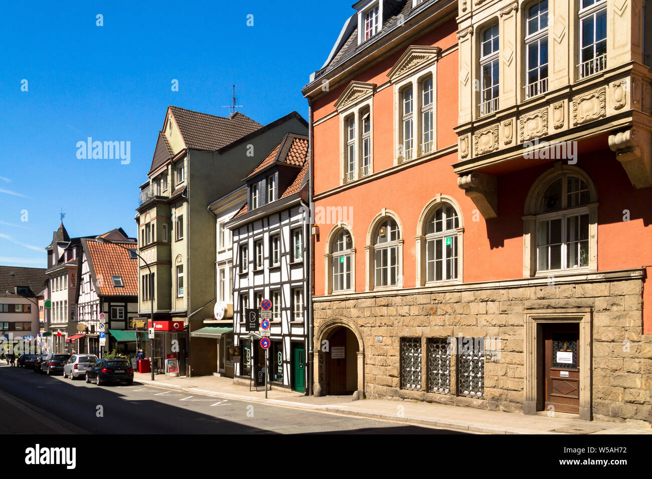 on the right the old town hall at the market square in the district Werden, houses on the Brueckstreet, Essen, Ruhr Area, Germany.  rechts das Alte Ra Stock Photo