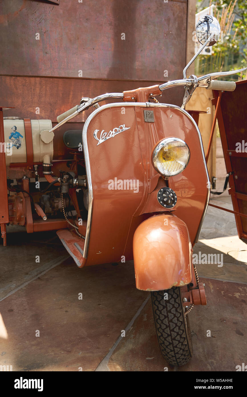 London, UK - July, 2019. Details of a Piaggio Vespa scooter. Stock Photo