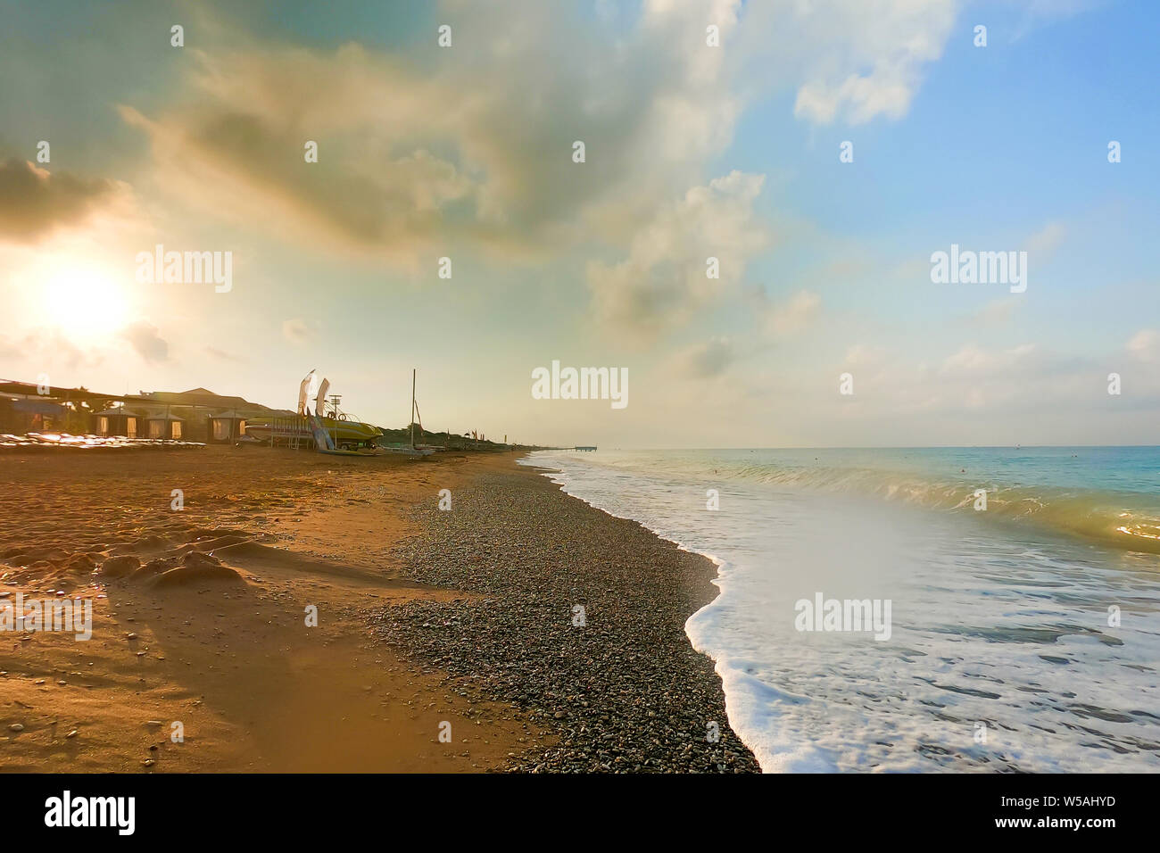 The storm is coming to the sea coast, bright colors of the sky and sea water. Stock Photo