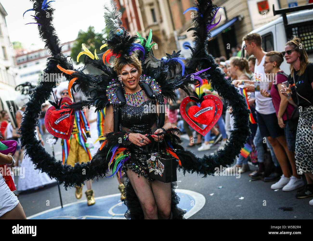 "Stuttgart, Germany. 27th July, 2019. Disguised participants march through the city centre at the Christopher Street Day (CSD) parade. The political parade stands for the rights of gays, lesbians, bisexuals and transgender people under the motto ""Courage to Freedom"". Credit: Christoph Schmidt/dpa/Alamy Live News Stock Photo"