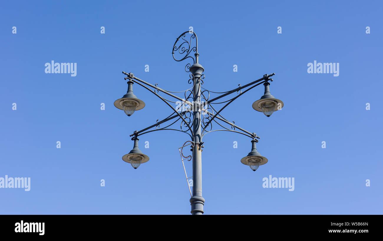 retro vintage street lamp isolated on blue background. Stock Photo