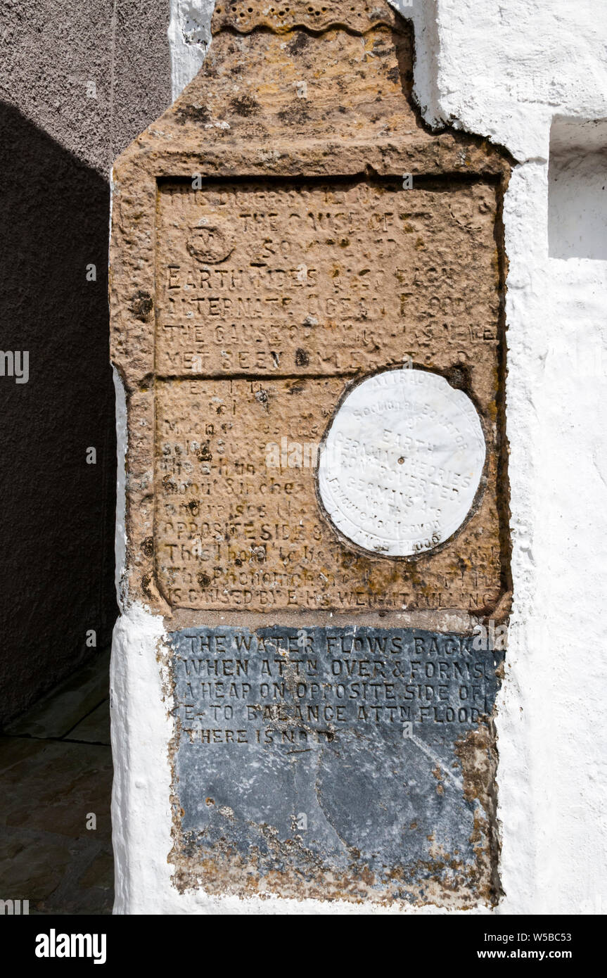 This inscription on a house in Scalloway, concerning 'earth tides' dates to 1910 and was the work of William Johnson, a local stonemason. Stock Photo