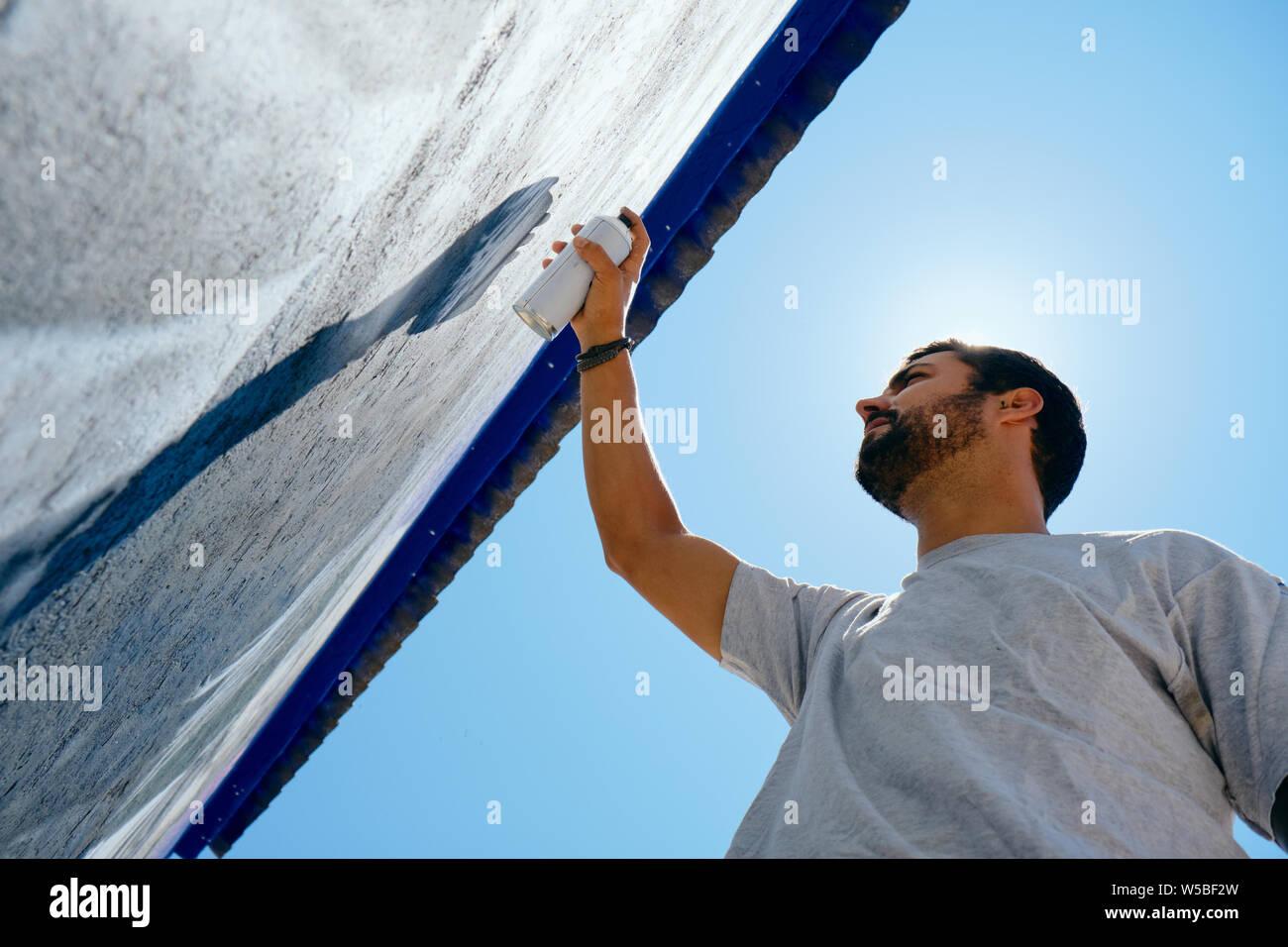 Man Painting Graffiti Along The Camino de Santiago Stock Photo