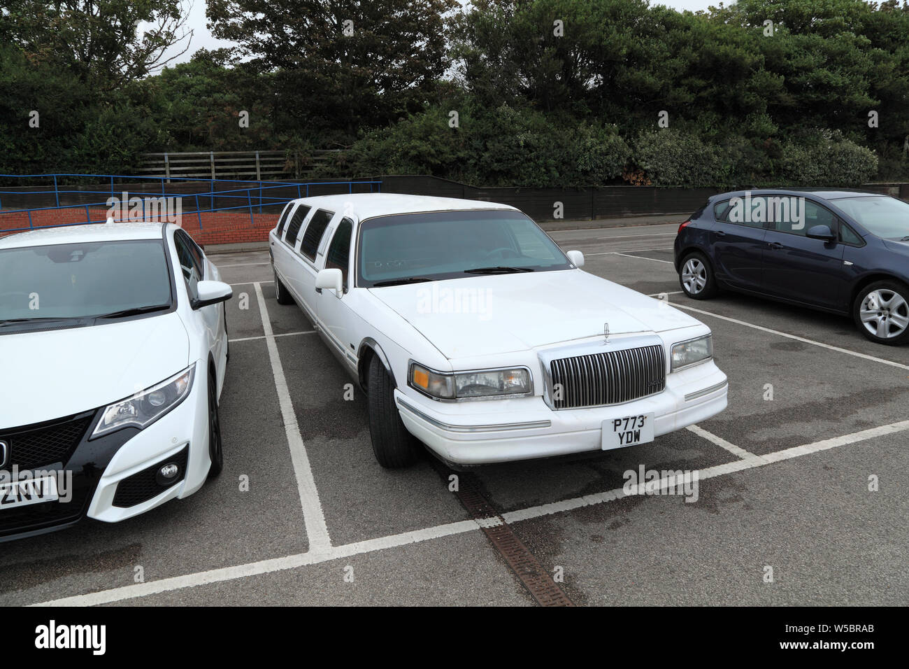 Stretch Limousine, Limo, Lincoln manufacture, car, vehicle, taking 2 bays, parking bays Stock Photo