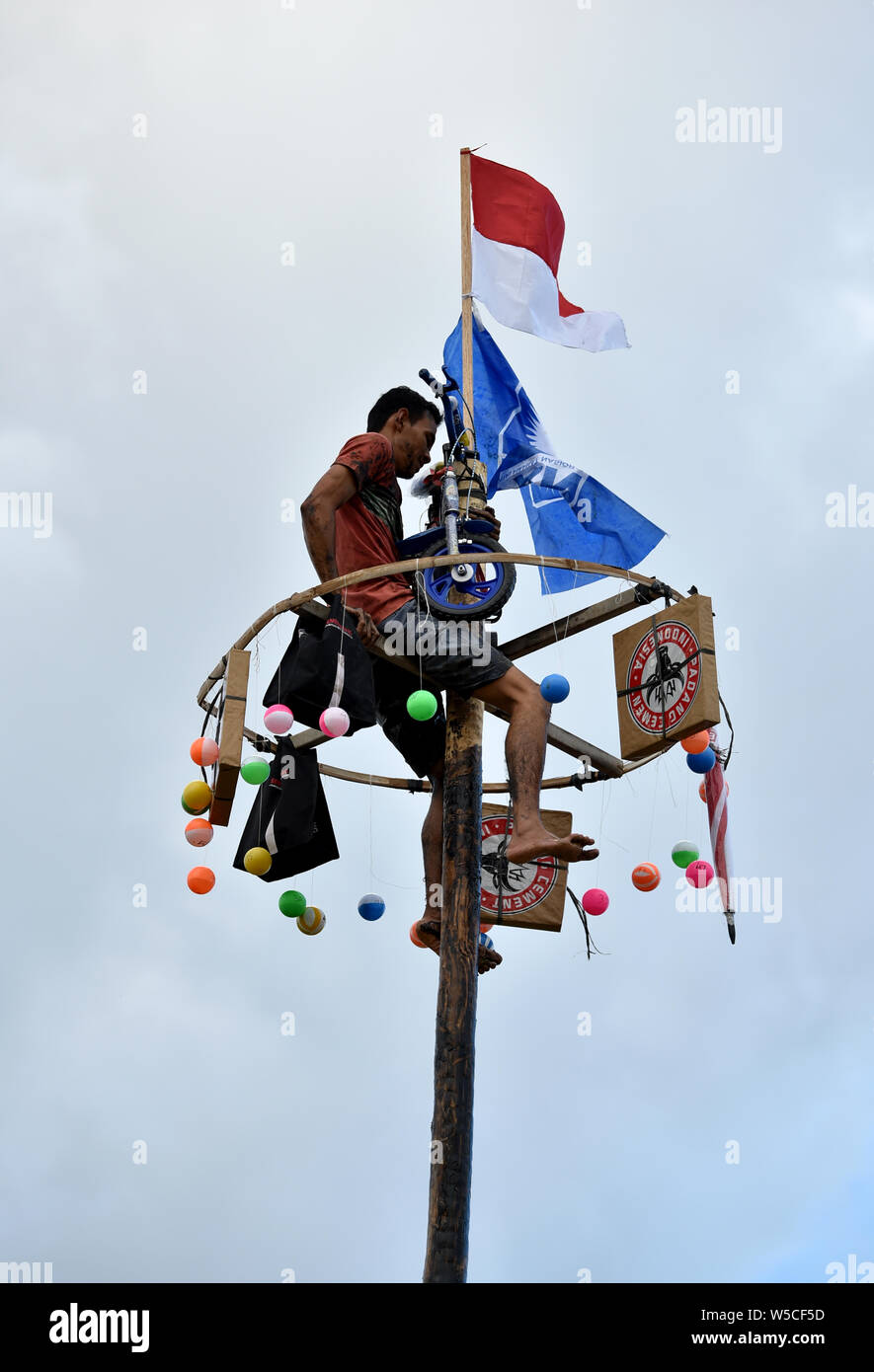 Banda Aceh, Indonesia - August 17, 2017: Celebrated the 70th anniversary of Independence. Man teams try to climb to the top of greased pole. Stock Photo
