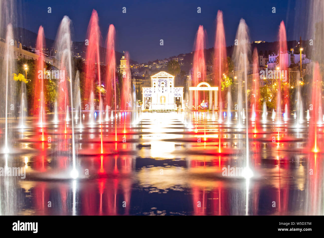 City of Nice cityscape and Fontaine Miroir d eau park evening view, Alpes-Maritimes region of France Stock Photo