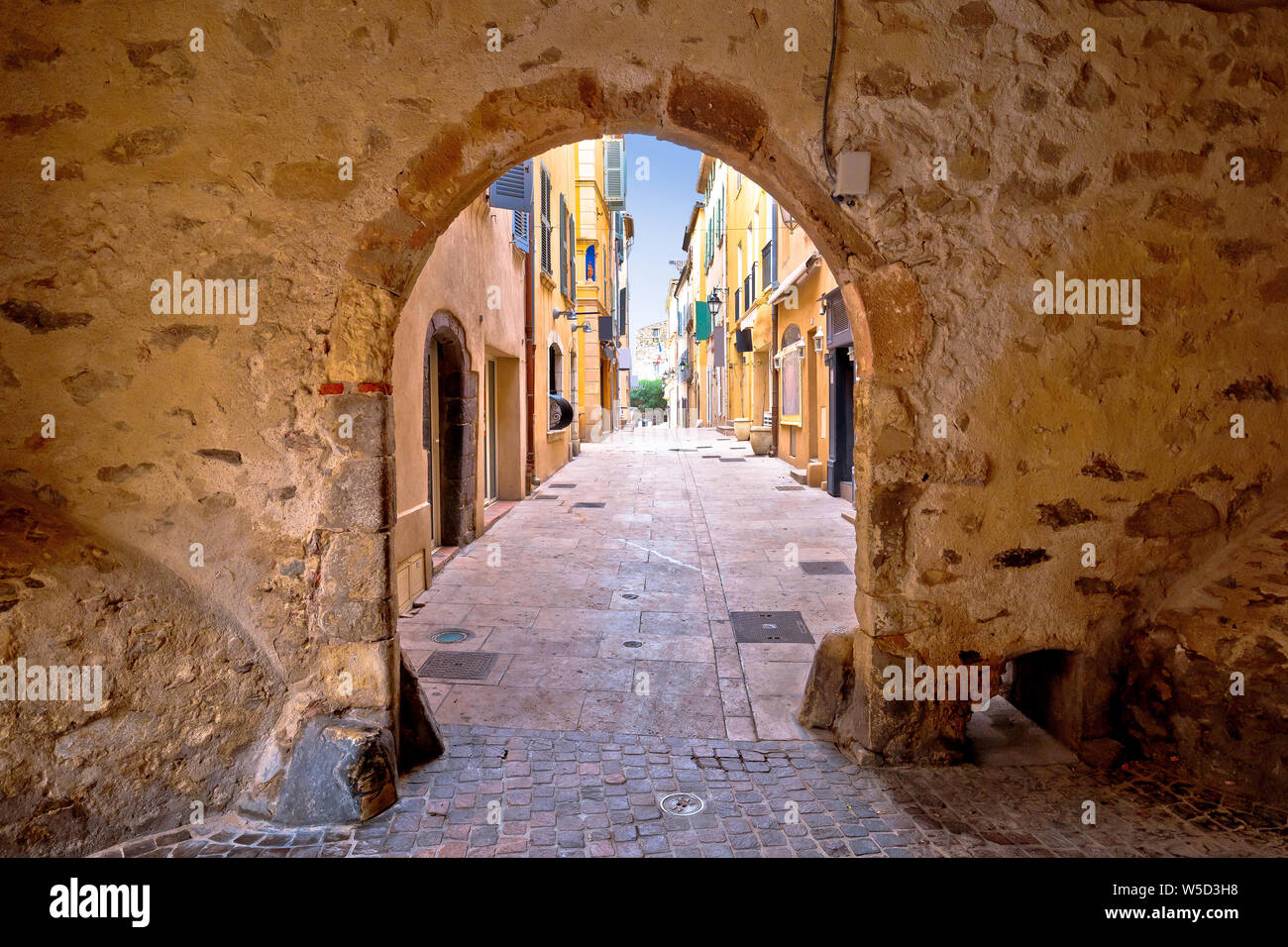 Saint Tropez historic town gate and colorful street view, tourist destination of French riviera Stock Photo