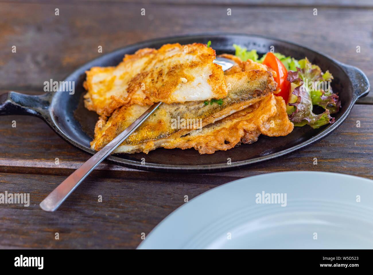 Main dish a fish pan with potatoes Stock Photo