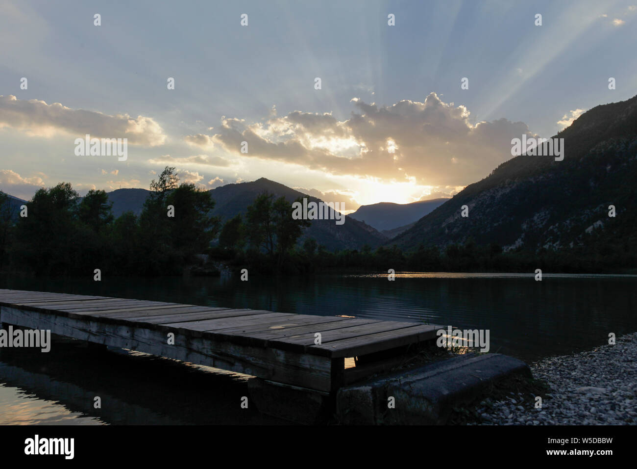 Light rays during the golden hour above a lake in south france Stock Photo