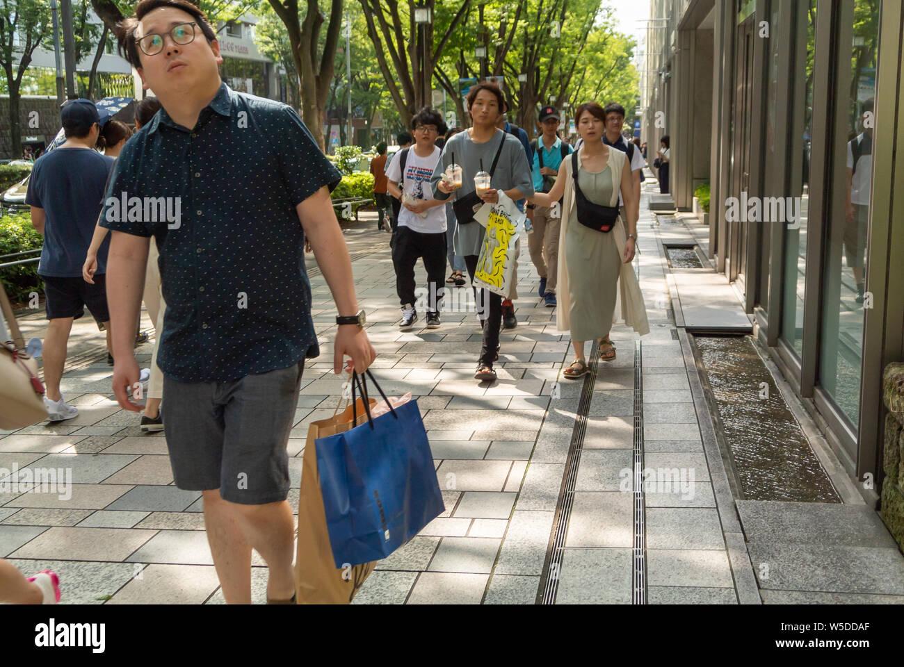 Japanese Pedestrians in the street of Omotesando, tokyo, japan, 2019 Stock Photo