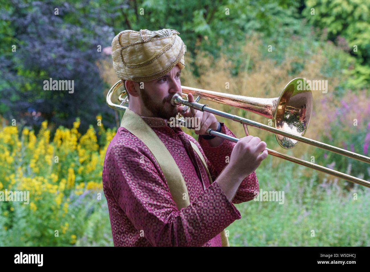Trombone Player from The Bombay Baja Brass Band, Valley Gardens, Harrogate, North Yorkshire, England, UK. Stock Photo