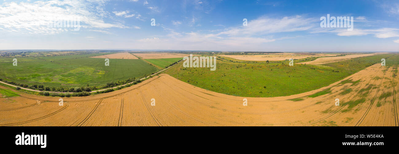 Wide panoramic landscape of farmland, summer time. Aerial view of countryside. Stock Photo